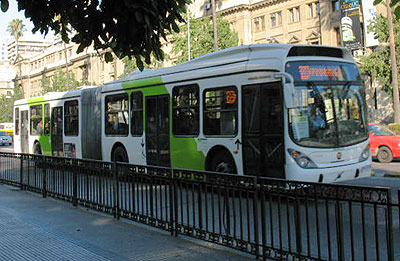 White and green buses like this one take you from one city region to another.